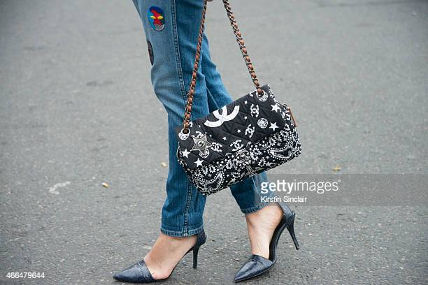 Buyer and social media director Juliana Lazara wears a Chanel bag Alexander Wang shoes and Stella McCartney jeans on day 7 of Paris Collections Women...