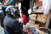 Buyer checking molasses Chaku on 06 January 2015 at Tokha Kathmandu Nepal for the celebration of Maghe Sankranti Festival celebrated on 15th January...