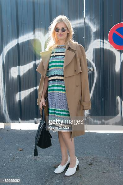 Buyer for Parlour X Eva Galambos wears a Celine dress bag and shoes Oliver Peoples sunglasses and Maison Margiela coat on day 6 of Paris Collections...
