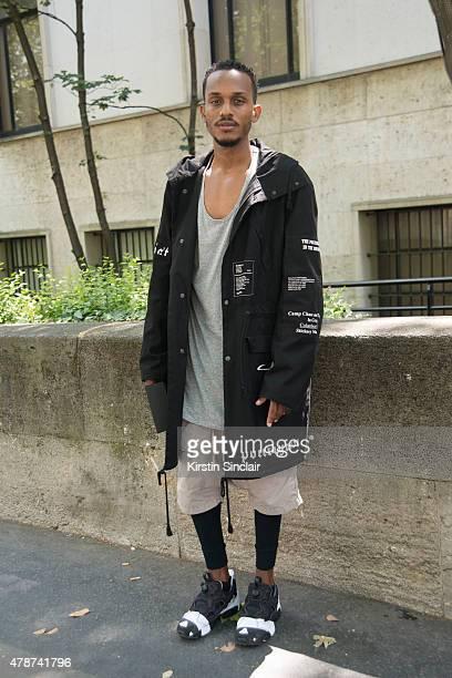 Buyer from ANROSA boutique Livai Ramin wears Raf Simons jacket Boris Bidjan Saberi shoes Rick Owens pants and Fear of God singlet on day 3 of Paris...