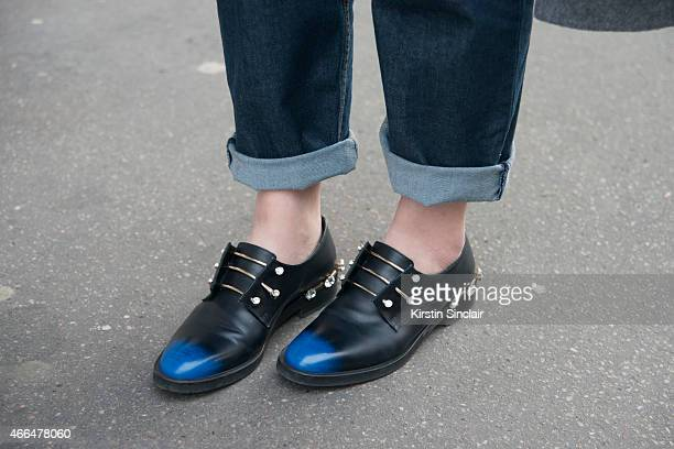 Buyer Janet Tseung wears Coliac shoes and Balenciaga jeans on day 7 of Paris Collections Women on March 09 2015 in Paris France