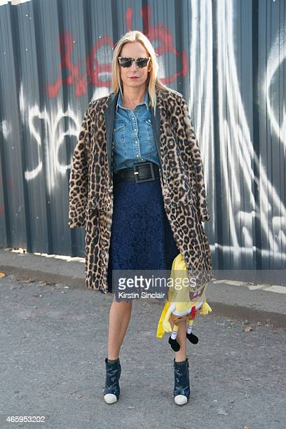 Buyer Katherine Bruss wears a Valentino skirt Celine coat Chanel shoes and Burberry sunglasses on day 6 of Paris Collections Women on March 08 2015...