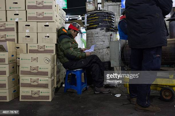 A buyer looks at auction information ahead of a shitake mushroom auction at Garak Market operated by Seoul AgroFisheries Food Corp in Seoul South...
