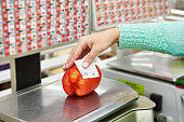Buyer weighs bell pepper in a store
