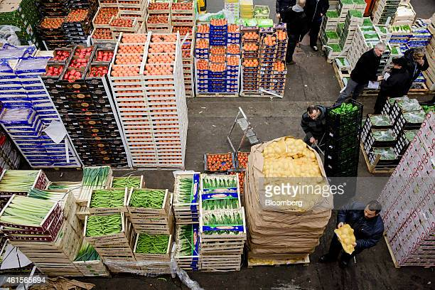 Buyers and wholesalers look at fresh produce in the fruit and vegetable section of Rungis wholesale food market in Rungis France on Thursday Jan 15...