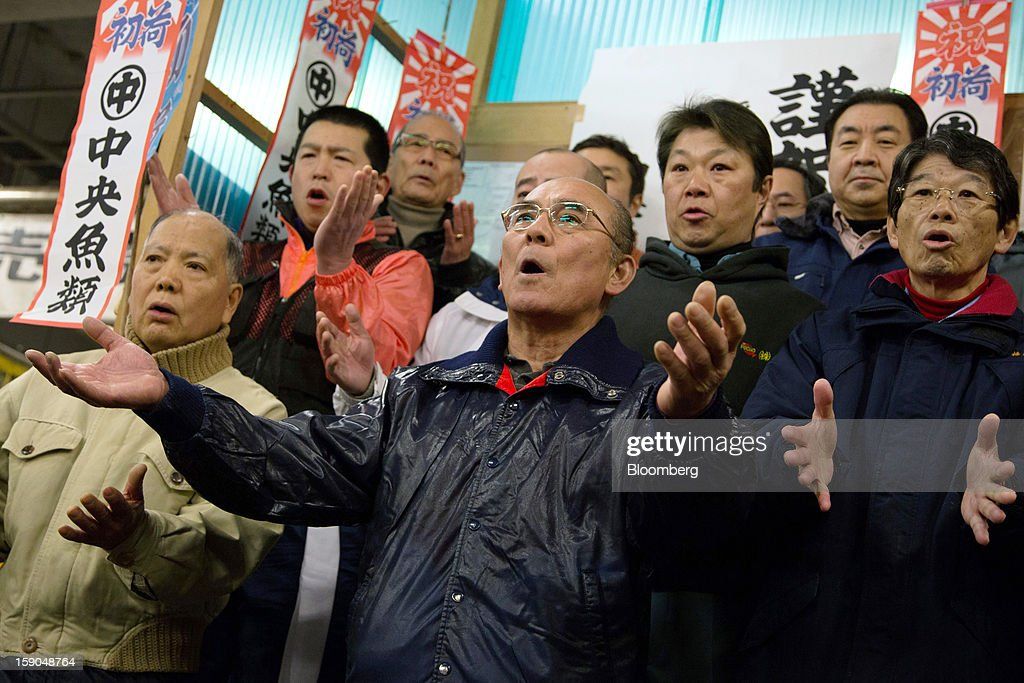 Buyers clap during the ceremony held prior to the year's first auction at Tsukiji Market in Tokyo, Japan, on Saturday, Jan. 5, 2013. Kiyomura K.K., a Tokyo-based sushi chain operator, outbid rivals for a second year in a row for the most expensive fish ever sold at the market, saying the purchase may help improve Japan-China relations. Photographer: Noriyuki Aida/Bloomberg via Getty Images