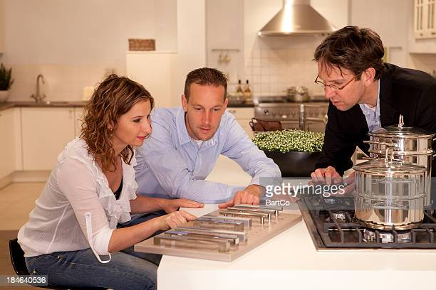 Buyers looking at kitchen