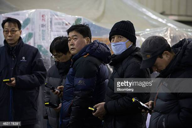 Buyers take part in a shitake mushroom auction at Garak Market operated by Seoul AgroFisheries Food Corp in Seoul South Korea on Wednesday Jan 15...
