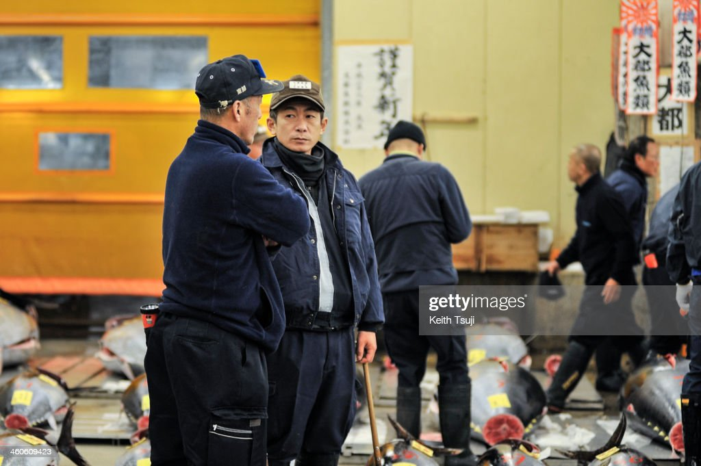 Buyers talk with each other before the year's first auction at Tsukiji Fish Market on January 5, 2014 in Tokyo, Japan. Tsukiji Fish Market is best known as one of the world's most famous fish markets, handling thousands of tons of seafood daily.