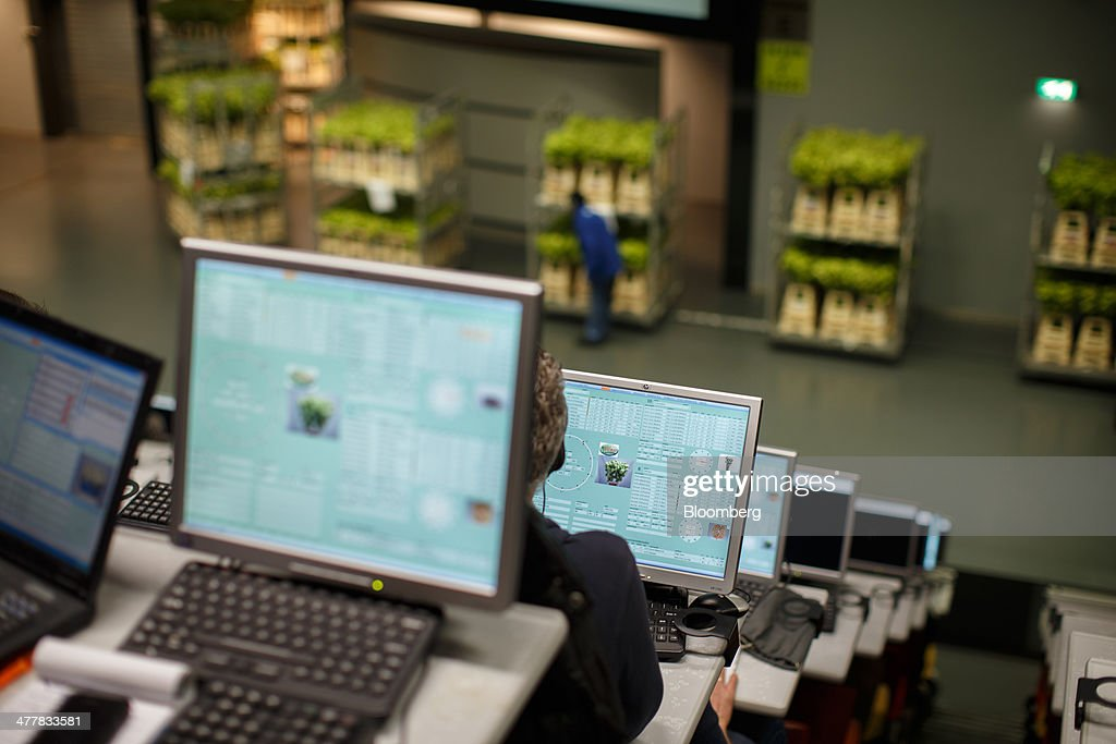 Buyers use desktop computers as flowers are auctioned at FloraHolland, the largest flower trade center in the world, in Aalsmeer, Netherlands, on Tuesday, March 11, 2014. The Netherlands' flower and plant exports, the world's biggest, fell 2.3 percent last year as declining consumer purchasing power was compounded by cold spring weather in Europe and a summer heat wave that hurt sales. Photographer: Jasper Juinen/Bloomberg via Getty Images