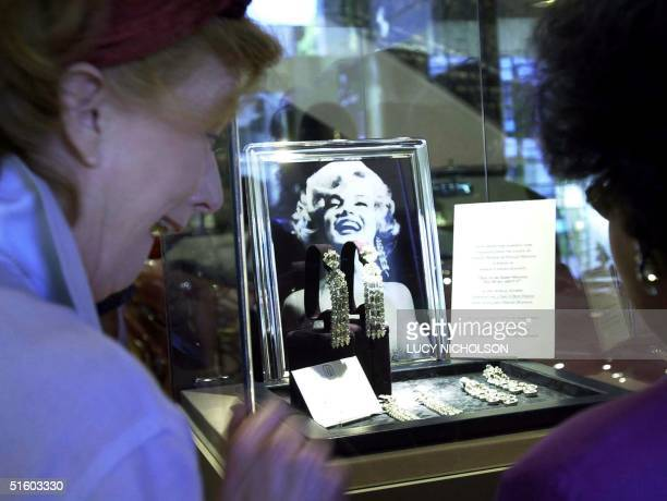 Buyers view earrings Marilyn Monroe wore to sing 'Diamonds are a Girl's Best Friend' in the film 'Gentlemen Prefer Blondes' and to sing 'Happy...