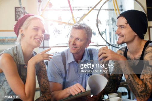 Buying an Antique Bicycle : Stock Photo