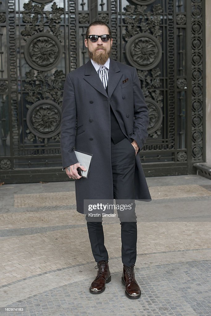 Buying director for Mytheresa.com Justin O'Shea wears Prada jacket , Acne shirt and trousers, Louis Vuitton shoes and Oliver Peoples sunglasses on day 2 of Paris Womens Fashion Week Autumn/Winter 2013 on March 1, 2013 in Paris, France.