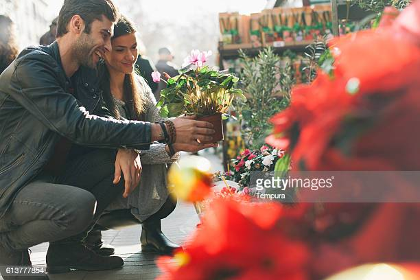 Buying flowers with his girfriend in Barcelona ramblas.