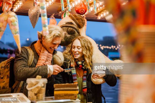 Buying Sweets At Winter Market