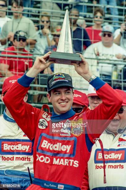 Buzz Calkins celebrates after winning the Indy 200 Indy Racing League IRL race at Walt Disney World Speedway Speedway on January 27 1996 in Orlando FL