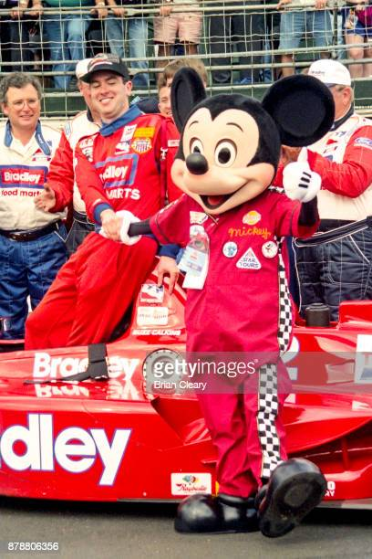 Buzz Calkins L celebrates with Mickey Mouse after winning the Indy 200 Indy Racing League IRL race at Walt Disney World Speedway Speedway on January...