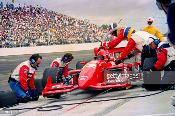Buzz Calkins makes a pit stop in the Reynard Ford Cosworth during the Indy 200 Indy Racing League IRL race at Walt Disney World Speedway Speedway on...