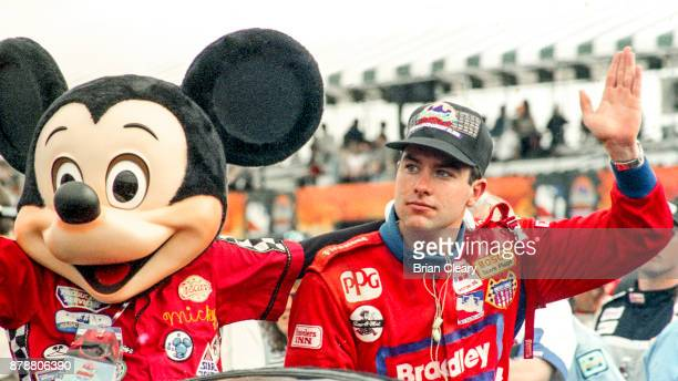 Buzz Calkins R celebrates with Mickey Mouse after winning the Indy 200 Indy Racing League IRL race at Walt Disney World Speedway Speedway on January...