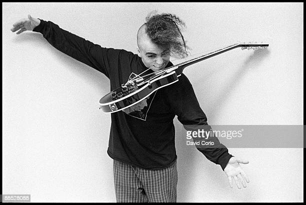 Buzz Osborne lead singer and guitarist of The Melvins holding a guitar with his teeth at Atlantic Records in London England on October 30 1991