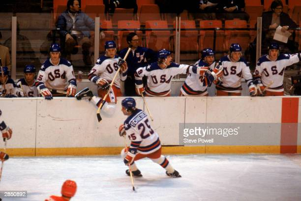 Buzz Schneider of the United States skates in front of his bench as time winds down during the Olympic hockey game against the Soviet Union on...