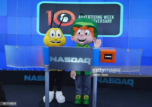 Buzz the Bee and Lucky Charms Leprechaun ring the closing bell at NASDAQ MarketSite on September 23 2013 in New York City
