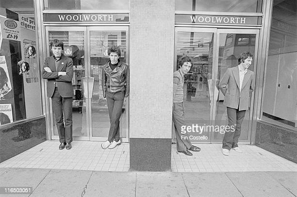 drummer John Maher bassist Steve Garvey guitarist and singer Pete Shelley and guitarist Steve Diggle British punk band pose for a group portrait...