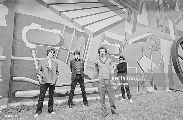 guitarist Steve Diggle drummer John Maher guitarist and singer Pete Shelley and bassist Steve Garvey British punk band pose for a group portrait...