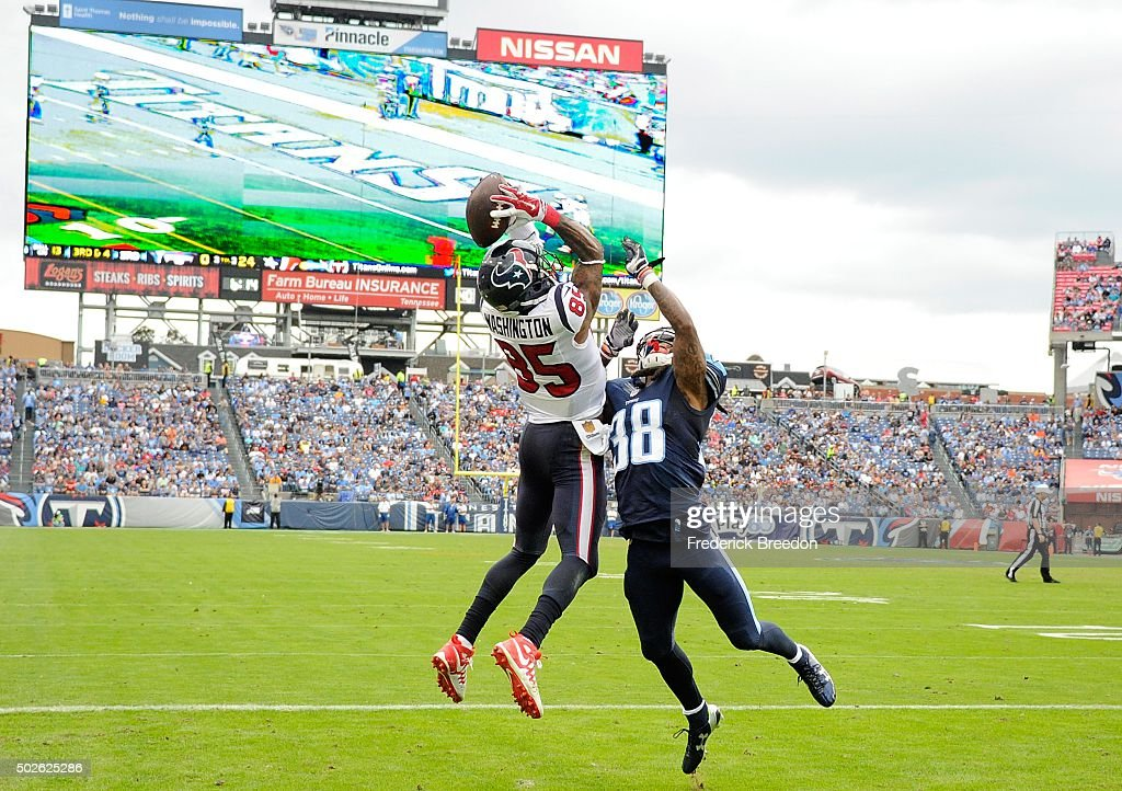 Webb #38 of the Tennessee Titans unsuccessfully defends <a gi-track='captionPersonalityLinkClicked' href=/galleries/search?phrase=Nate+Washington&family=editorial&specificpeople=748657 ng-click='$event.stopPropagation()'>Nate Washington</a> #85 of the Houston Texans as he makes a touchdown reception during the second half at Nissan Stadium on December 27, 2015 in Nashville, Tennessee.