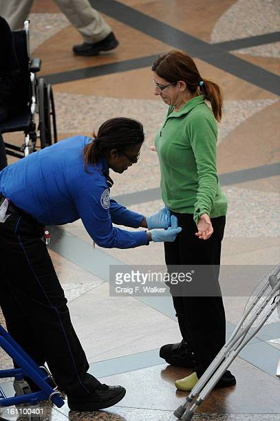 111710_PATDOWN_CFW by a Transportation Security Administration agent while passing through security at Denver International Airport in Denver CO...