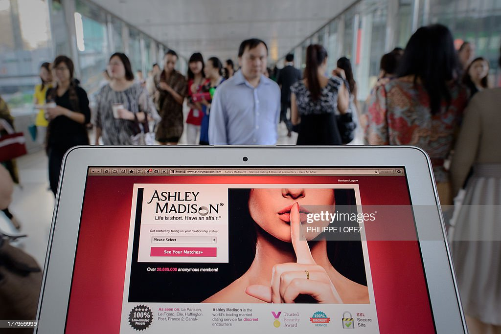 SEX, FOCUS by Aaron Tam This photo illustration taken on August 20, 2013 shows the homepage of the Ashley Madison dating website displayed on a laptop in Hong Kong. The founder of a dating service promoting adultery is setting his sights on China's cheating hearts after a controversial launch in Hong Kong. AFP PHOTO / Philippe Lopez