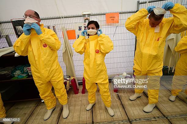 STORY by Alex PIGMAN Volunteers train at a Doctors Without Borders replica of Ebola treatment centres prior to be sent to help fight the spread of...