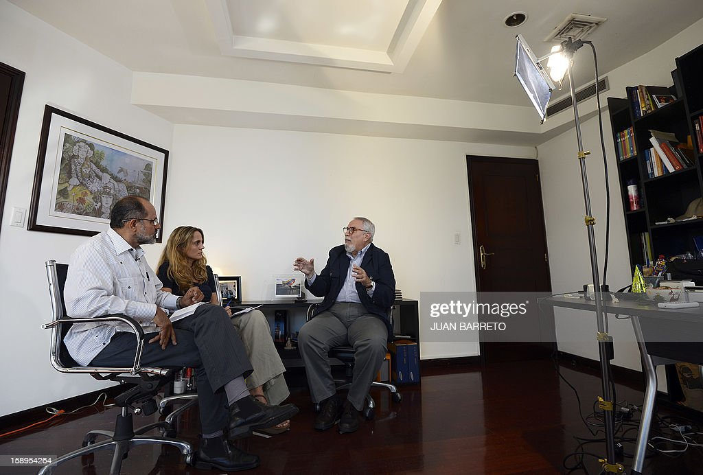 STORY by Anna Pelegri Ramon Guillermo Aveledo (R), head of Venezuela's opposition umbrella group MUD, speaks during an interview offered on January 4, 2013 in Caracas. AFP PHOTO