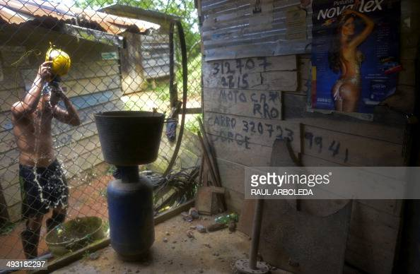 STORY by Ariela Navarro A miner cools himself down at an unlicensed gold mine in Segovia municipality department of Antioquia Colombia on May 20 2014...