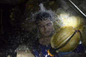 STORY by Ariela Navarro A miner cools himself down at 'La Primavera' a licensed gold mine in Segovia municipality department of Antioquia Colombia on...