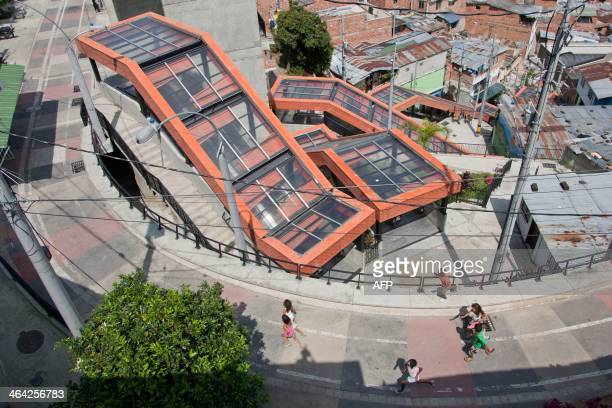 STORY by Ariela Navarro Children run near covered outdoor escalators at Comuna 13 one of the poorest neighbourhoods of Medellin Antioquia department...