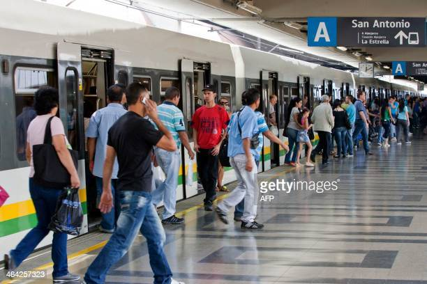 STORY by Ariela Navarro People get off the metro at a station in Medellin Antioquia department Colombia on January 5 2014 In 2013 Medellin was chosen...