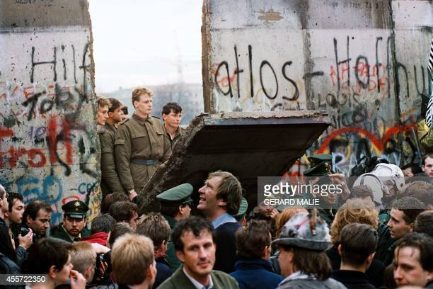 STORY by Audrey KAUFFMANN and PACKAGE 'GermanyeastHistory20years' FILES West Berliners crowd in front of the Berlin Wall early 11 November 1989 as...