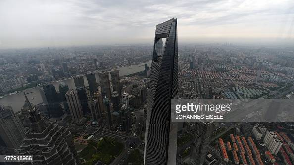 FOCUS by Bill Savadove This picture taken on May 8 2015 shows a view of the Shanghai World Financial Center from the new Shanghai Tower which is...