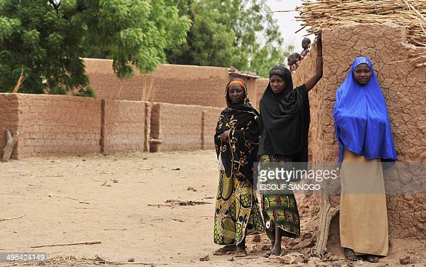 STORY by Boureima HAMA Photo taken on May 28 2012 shows inhabitants watching a ceremony in the village of Tibiri near Dosso in Niger Although the...