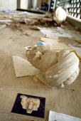 STORY by BRYAN PEARSON FILES Parts of a beheaded sculpture lies among rubble after a mob of looters ransacked and looted Iraq's largest archeological...
