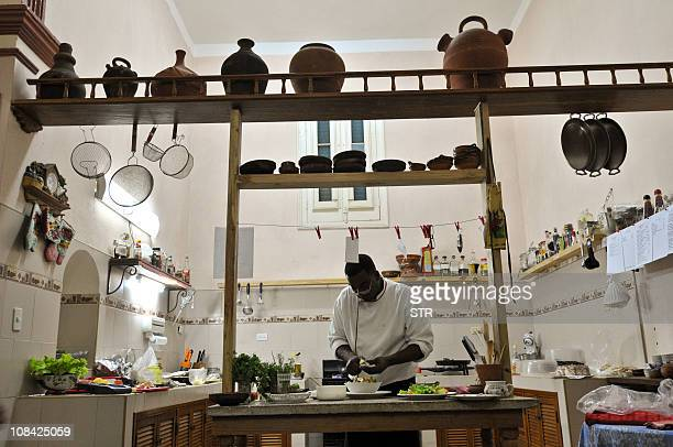 STORY by Carlos Batista Carlos Marquez owner of the 'paladar' 'San Cristobal' prepares a dish on January 9 2011 in Havana Following the new economic...
