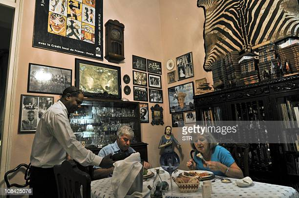 STORY by Carlos Batista Customers enjoy a meal at the 'paladar' 'San Cristobal' on January 9 2011 in Havana Following the new economic rules adopted...
