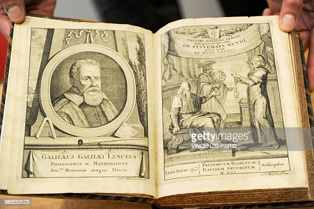 STORY by Catherine Jouault An unidentified person shows Galileo's book 'De sistemate mundi' at the Vatican's astronomic observatory center in...