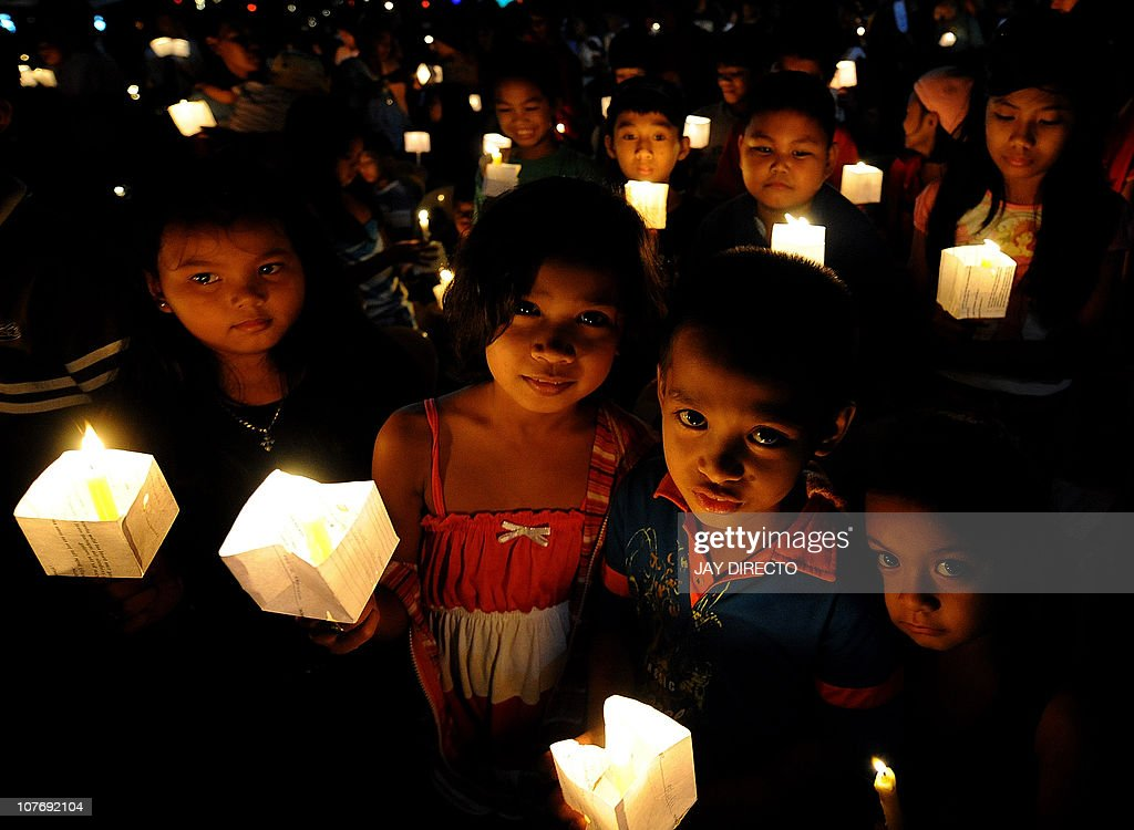 STORY 'LIFESTYLE-IT-PHILIPPINES-CRIME-PORNOGRAPHY' by Cecil MorellaChildren hold lighted candles during a prayer for Justice and Protection against Sex Trafficking of Children and Young People in Quezon City suburban Manila on December 12, 2010, as part of the annual observance of International Day against Human Trafficking. Cybersex dens are a growing problem in the impoverished Southeast Asian nation that has long struggled to curb child prostitution, according to law enforcers and social workers.