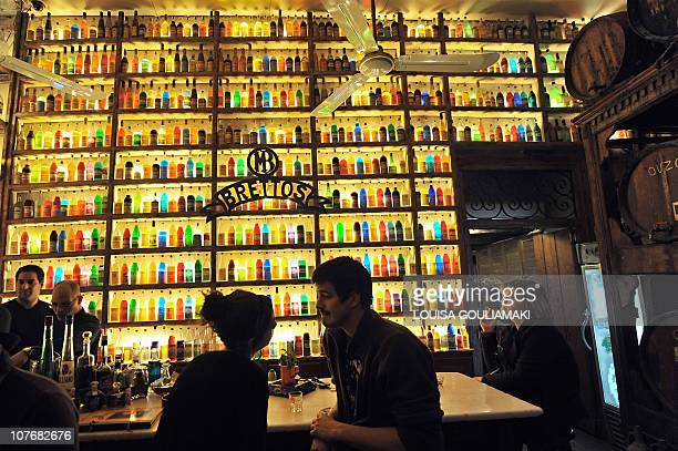 In this picture taken on April 8 2010 Customers drink at Brettos Bar and distillery near the Acropolis in the historic district of Plaka in Athens...