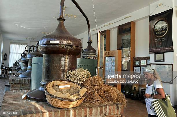 In this picture taken on September 3 2010 a tourist visits the 150 year old Barbayannis ouzo distillery museum at Plomari on the Aegean island of...
