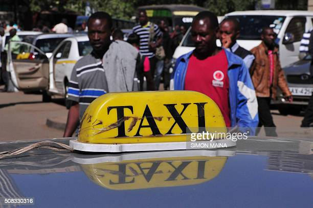 STORY by Cyril BELAUD A picture taken on February 4 2016 shows Kenyan taxi parked in a street of Nairobi waiting for clients on February 4 2016 In...