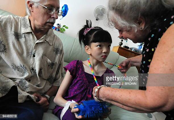 STORY 'HEALTHCHINAUSPALSY' by Dan Martin US couple John and Maggie Davies and their daughter Qiongjian severely disabled by cerebral palsy and autism...