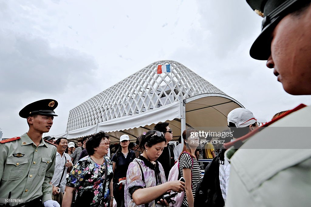 STORY 'CHINA-EXPO2010-POLITICS-DEMOCRACY' by D'Arcy Doran PLA soldiers maintain order as visitors queue in front of the French pavilion at the site of the World Expo 2010 in Shanghai on June 3, 2010